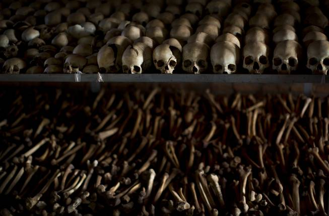 The skulls and bones of some of those who were slaughtered as they sought refuge inside the church are laid out as a memorial to the thousands who were killed in and around the Catholic church during the 1994 genocide in Ntarama, Rwanda, Friday, April 4, 2014.