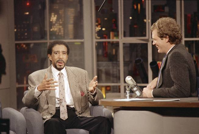 "Comedian Richard Pryor gesture while sharing a laugh with David Letterman during the ""David Letterman Show"" in New York Thursday, January 15, 1987. Pryor is starring in the film ""Critical Condition."""