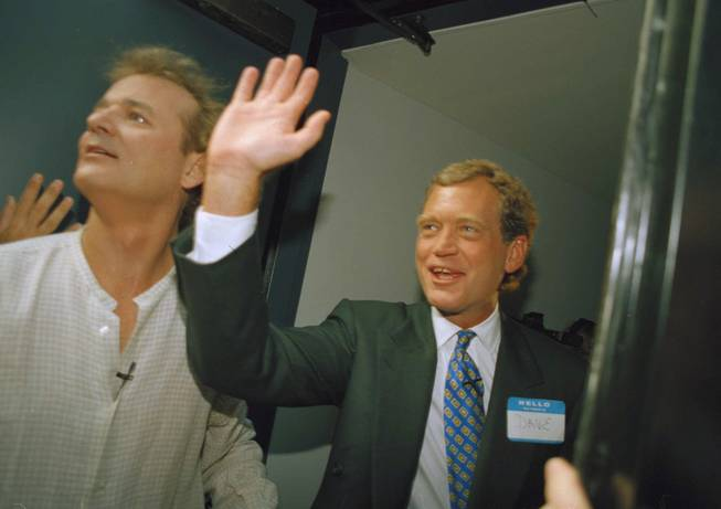 David Letterman, right, and Bill Murray wave from the side door of the Ed Sullivan Theater in New York on Monday, August 30, 1993.