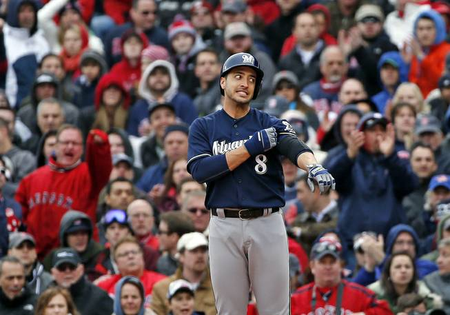 Milwaukee Brewers' Ryan Braun (8) pauses at first base after grounding out in the seventh inning of a baseball game against the Boston Red Sox at Fenway Park on Friday, April 4, 2014, in Boston.