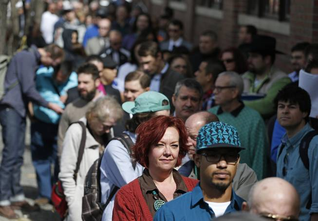 In this Thursday March 13, 2014, file photo, job seekers line up to attend a marijuana industry job far in Downtown Denver.