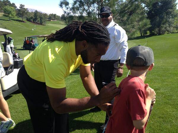 Larry Fitzgerald signs an autograph on opening day of the 2014 Michael Jordan Celebrity Invitational pro-am golf tournament Thursday, April 3, 2014, at Shadow Creek Golf Course.