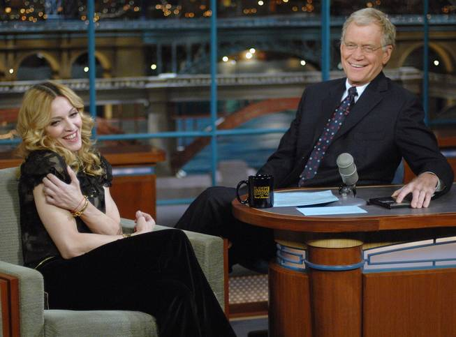 "In this Jan. 11, 2006, file photo released by CBS, Madonna joins host David Letterman on the set of ""The Late Show With David Letterman"" in New York."