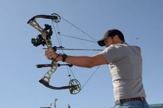 Luke Bryan takes part in the ACM & Cabela's Great Outdoor Archery Event during the 49th Annual Academy of Country Music Awards weekend at the Linq on Saturday, April 5, 2014 in Las Vegas.
