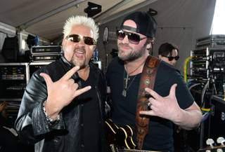 Guy Fieri and Lee Brice attend Day 2 of the 2014 ACM Party for a Cause at the Linq on Saturday, April 5, 2014, in Las Vegas.