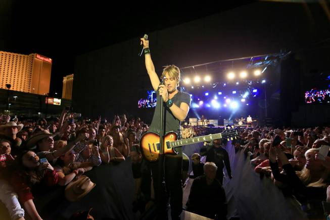 Keith Urban performs during Day 2 of the 2014 ACM Party for a Cause at the Linq on Saturday, April 5, 2014, in Las Vegas.