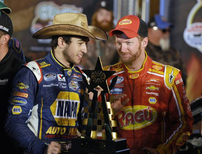 Chase Elliott, left, talks with team owner Dale Earnhardt Jr. in Victory Lane after Elliot won the NASCAR Nationwide Series auto race at Texas Motor Speedway in Fort Worth, Texas, on Friday, April 4, 2014.