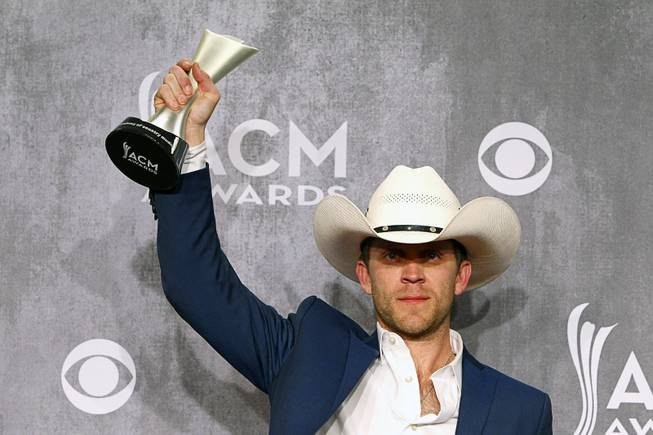 Justin Moore holds his trophy for New Artist of the Year in the photo room during the 49th Academy of Country Music Awards at the MGM Grand Garden Arena Sunday, April 6, 2014.