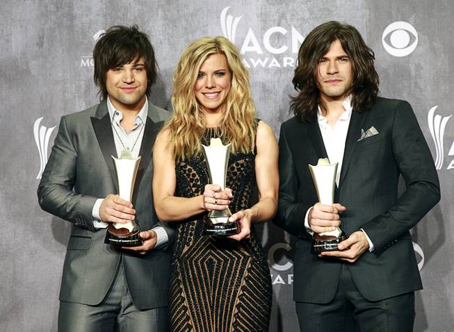 The Band Perry in the photo room at the 49th Academy of Country Music Awards at MGM Grand Garden Arena on Sunday, April 6, 2014, in Las Vegas. The group won the award for Vocal Group of the Year.