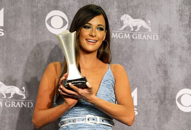 "Kasey Musgraves in the photo room during the 49th Academy of Country Music Awards at the MGM Grand Garden Arena Sunday, April 6, 2014. Lambert won for Female Vocalist of the Year, Single Record of the Year and Vocal Event of the Year for ""We Were Us"" with Keith Urban."