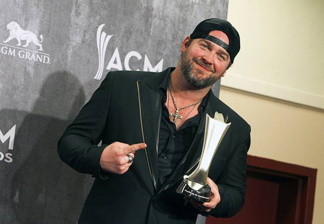 "Lee Brice poses in the photo room during the 49th Academy of Country Music Awards at the MGM Grand Garden Arena Sunday, April 6, 2014. Brice won the Song of the Year award for the song ""I Drive Your Truck""."