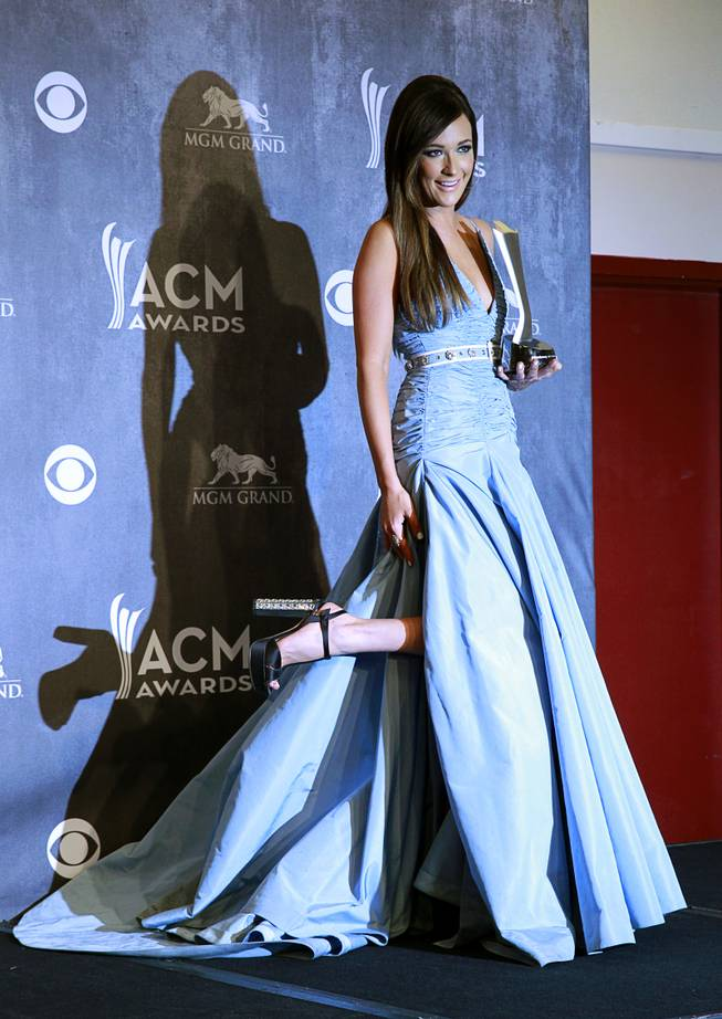 Album of the Year winner Kasey Musgraves poses in the photo room during the 49th Academy of Country Music Awards at the MGM Grand Garden Arena Sunday, April 6, 2014.