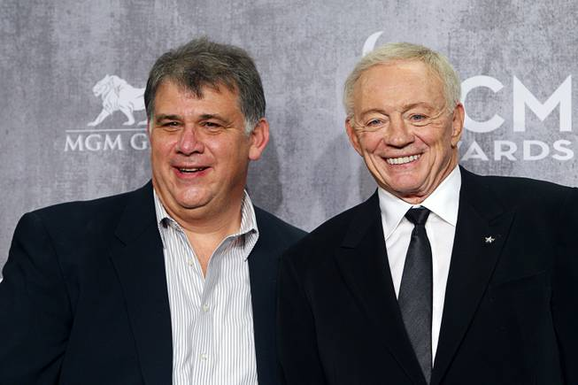 Academy of Country Music's President Bob Romero, left, poses with Dallas Cowboys owner Jerry Jones in the photo room during the 49th Academy of Country Music Awards at the MGM Grand Garden Arena Sunday, April 6, 2014. The 2015 ACMA show will be held at the AT&T Stadium in Texas.