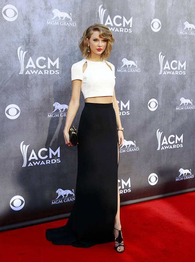 Taylor Swift arrives for the 49th Academy of Country Music Awards show at the MGM Grand Garden Arena Sunday, April 6, 2014.