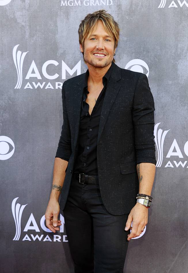 Keith Urban arrives for the 49th Academy of Country Music Awards show at the MGM Grand Garden Arena Sunday, April 6, 2014.