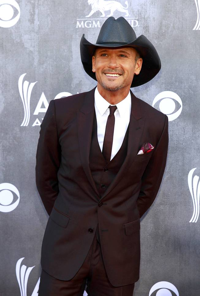Tim McGraw arrives for the 49th Academy of Country Music Awards show at the MGM Grand Garden Arena Sunday, April 6, 2014.