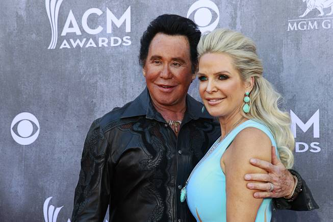 Wayne Newton and his wife Kathleen McCrone arrive for the 49th Academy of Country Music Awards at MGM Grand Garden Arena on Sunday, April 6, 2014, in Las Vegas.