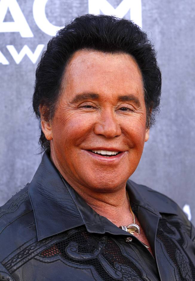 Wayne Newton arrives for the 49th Academy of Country Music Awards show at the MGM Grand Garden Arena Sunday, April 6, 2014.