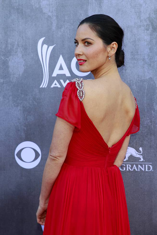 Actress Olivia Munn arrives for the 49th Academy of Country Music Awards show at the MGM Grand Garden Arena Sunday, April 6, 2014.