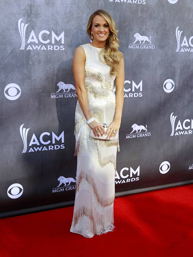 Carrie Underwood arrives for the 49th Academy of Country Music Awards show at the MGM Grand Garden Arena Sunday, April 6, 2014.
