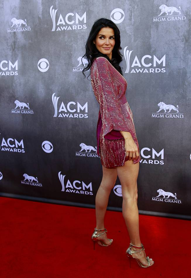 Actress Angie Harmon arrives for the 49th Academy of Country Music Awards show at the MGM Grand Garden Arena Sunday, April 6, 2014.