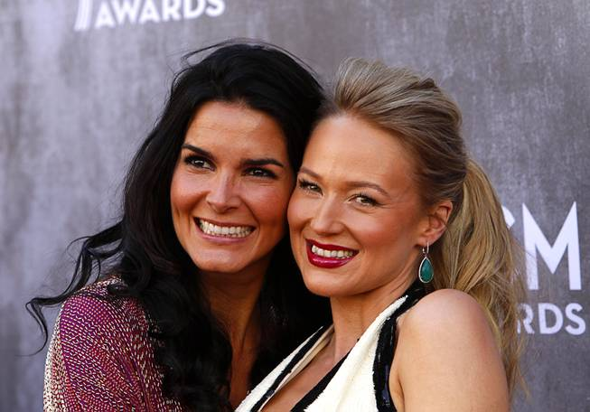Actress Angie Harmon, left, and singer Jewel arrive for the 49th Academy of Country Music Awards show at the MGM Grand Garden Arena Sunday, April 6, 2014.