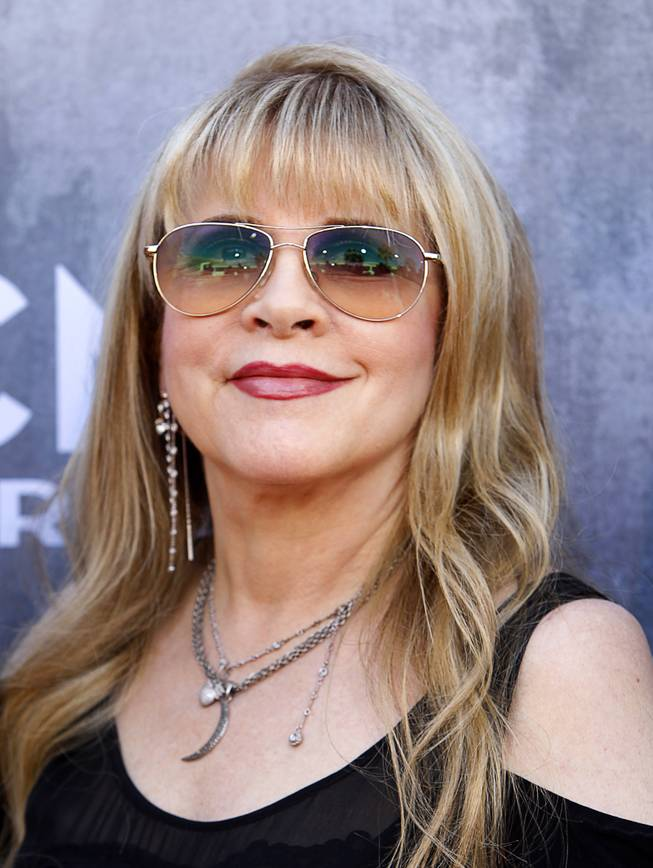 Singer Stevie Nicks arrives for the 49th Academy of Country Music Awards show at the MGM Grand Garden Arena Sunday, April 6, 2014.