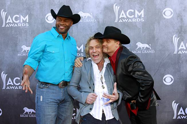Cowboy Troy and Big Kenny and John Rich of Big & Rich arrive for the 49th Academy of Country Music Awards at MGM Grand Garden Arena on Sunday, April 6, 2014, in Las Vegas.