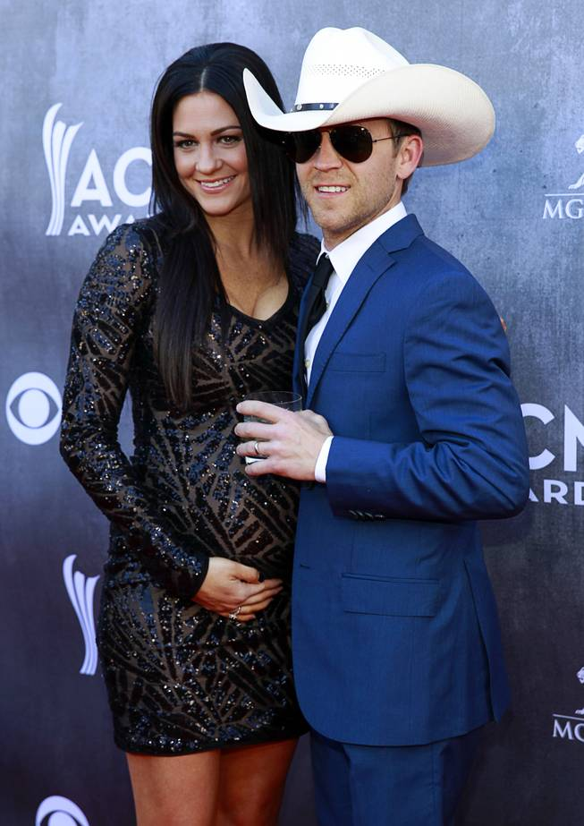 Justin Moore and his wife Kate arrive for the 49th Academy of Country Music Awards on Sunday, April 6, 2014, at MGM Grand Garden Arena.
