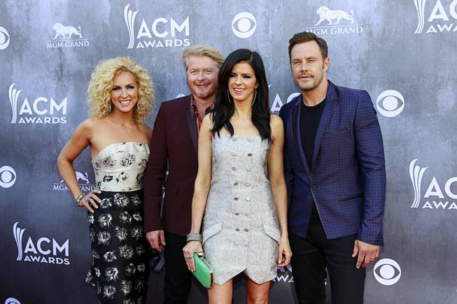 Members of Little Big Town, from left, Kimberly Schlapman, Philip Sweet, Karen Fairchild, and Jimi Westbrook, arrive for the 49th Academy of Country Music Awards show at the MGM Grand Garden Arena Sunday, April 6, 2014.