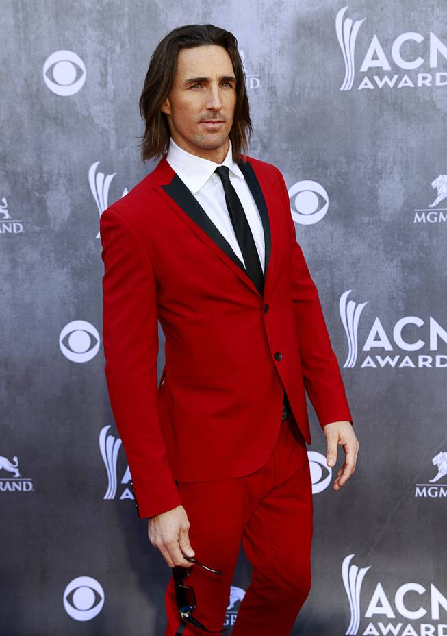 Jake Owen arrives for the 49th Academy of Country Music Awards show at the MGM Grand Garden Arena Sunday, April 6, 2014.