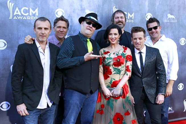 John Popper, center, and Blues Traveler with Shawna Thompson and Keifer Thompson of Thompson Square as they arrive for the 49th Academy of Country Music Awards at MGM Grand Garden Arena on Sunday, April 6, 2014, in Las Vegas.