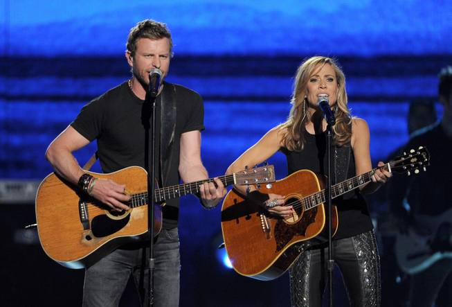 Dierks Bentley and Sheryl Crow perform onstage at the 49th annual Academy of Country Music Awards at MGM Grand Garden Arena on Sunday, April 6, 2014, in Las Vegas.