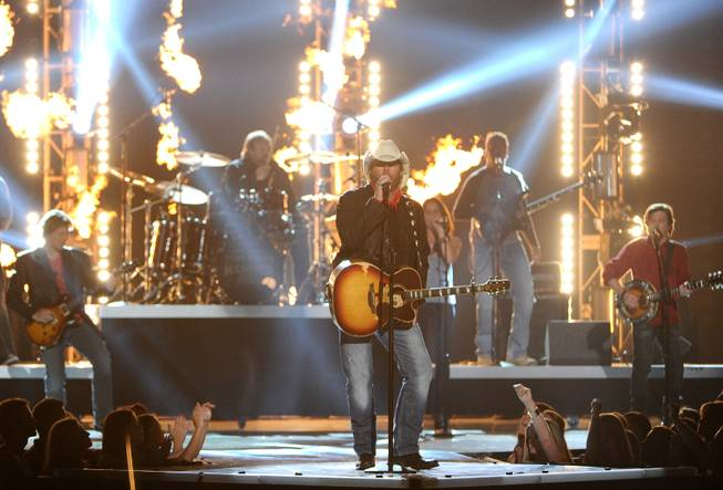 Toby Keith performs on stage at the 49th annual Academy of Country Music Awards at the MGM Grand Garden Arena on Sunday, April 6, 2014, in Las Vegas.