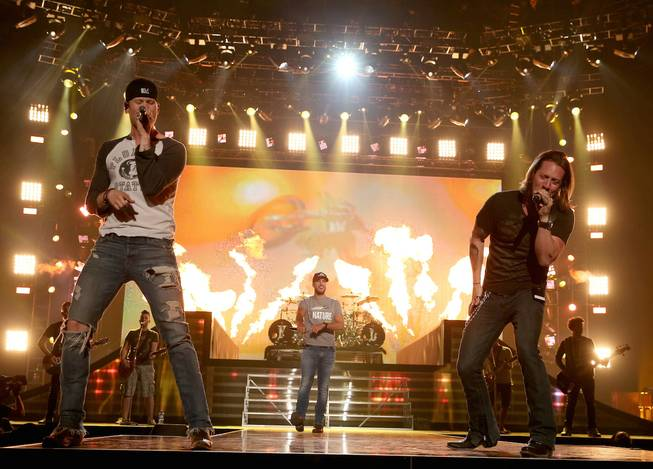 Co-host Luke Bryan, center, and Florida Georgia Line members Brian Kelley and Tyler Hubbard rehearse onstage for the ACM Fan Jam on Saturday, April 5, 2014, at Mandalay Bay Events Center.