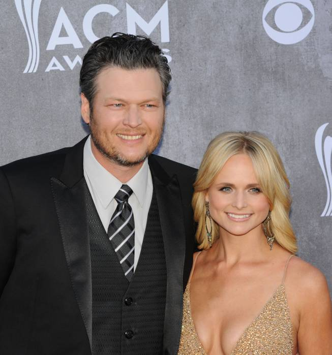 Blake Shelton and Miranda Lambert arrive on the red carpet at the 49th Annual Academy of Country Music Awards on Sunday, April 6, 2014, at MGM Grand Garden Arena.
