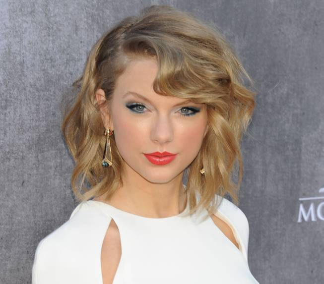 Taylor Swift arrives at the red carpet for the 49th Annual Academy of Country Music Awards at MGM Grand Garden Arena on Sunday, April 6, 2014, in Las Vegas.