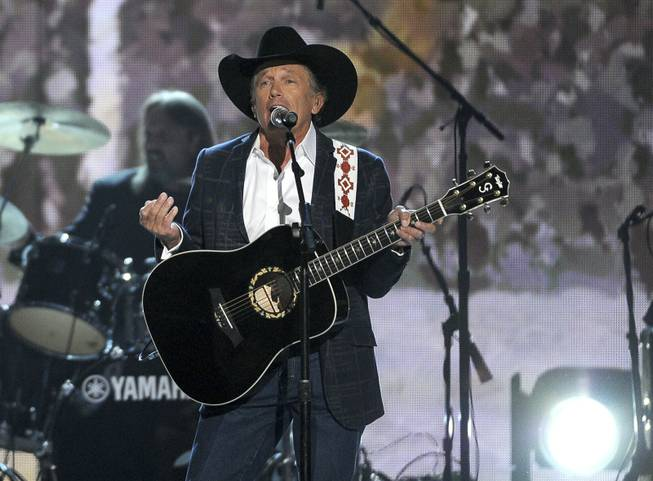 George Strait performs onstage at the 49th Annual Academy of Country Music Awards at MGM Grand Garden Arena on Sunday, April 6, 2014, in Las Vegas.