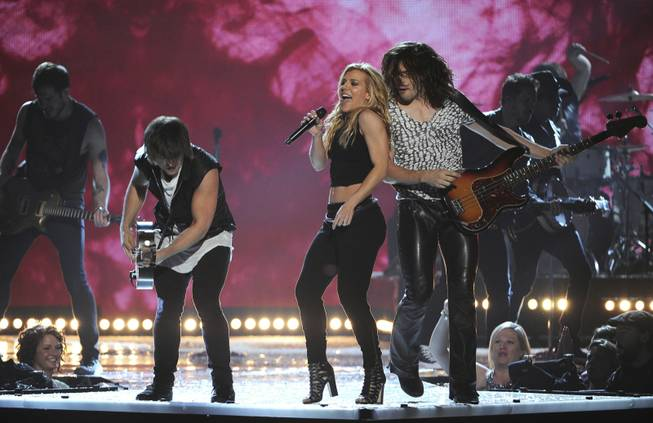 Neil Perry, Kimberly Perry and Reid Perry of The Band Perry open the 49th Annual Academy of Country Music Awards at MGM Grand Garden Arena on Sunday, April 6, 2014, in Las Vegas.