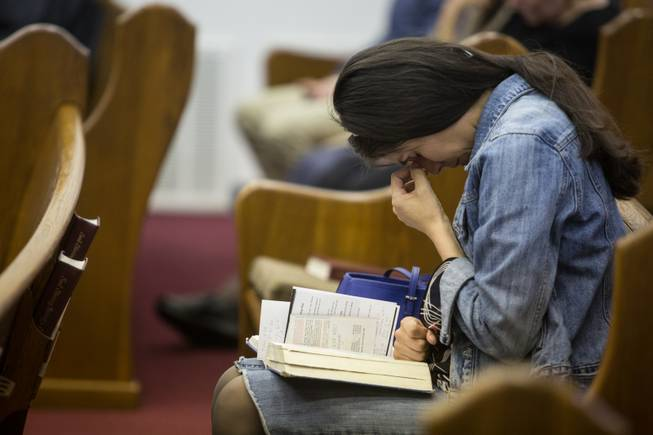 Kathy Abad, a military wife, prays for the victims and families affected by the Fort Hood shooting during a memorial service at the Tabernacle Baptist Church on Sunday, April 6, 2014, in Killeen, Texas. On April 2, 2014, three people were killed and 16 were wounded when a gunman opened fire before taking his own life at the Fort Hood military base.