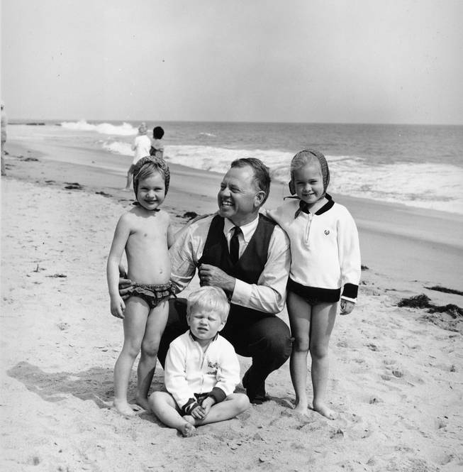 Actor Mickey Rooney is pictured with his children at a beach location in this undated photograph. From left are: daughter Kerry, 4, son Kyle, 3, and 5-year-old daughter Kelly, 5.