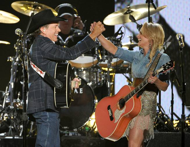 George Strait, left, and Miranda Lambert perform on stage at the 49th annual Academy of Country Music Awards at the MGM Grand Garden Arena on Sunday, April 6, 2014, in Las Vegas.