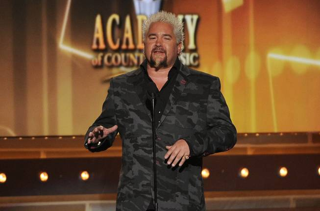 Guy Fieri speaks onstage at the 49th Annual Academy of Country Music Awards at MGM Grand Garden Arena on Sunday, April 6, 2014, in Las Vegas.