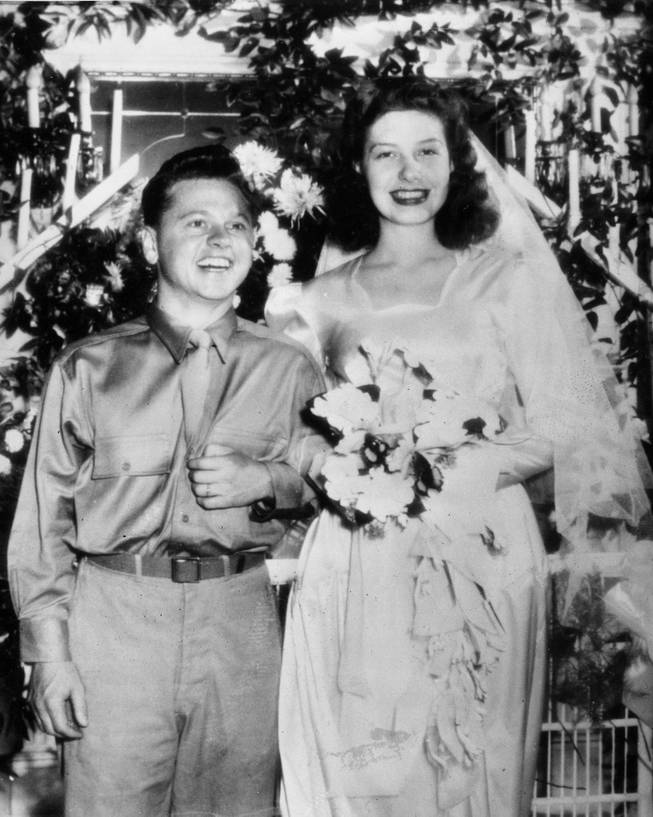 Pvt. Mickey Rooney, who is currently stationed for wartime service at Camp Sibert, Ala., and his bride Betty Jane Rase, 17, smile happily after their wedding ceremony, in Birmingham, Ala., on September 30, 1944.