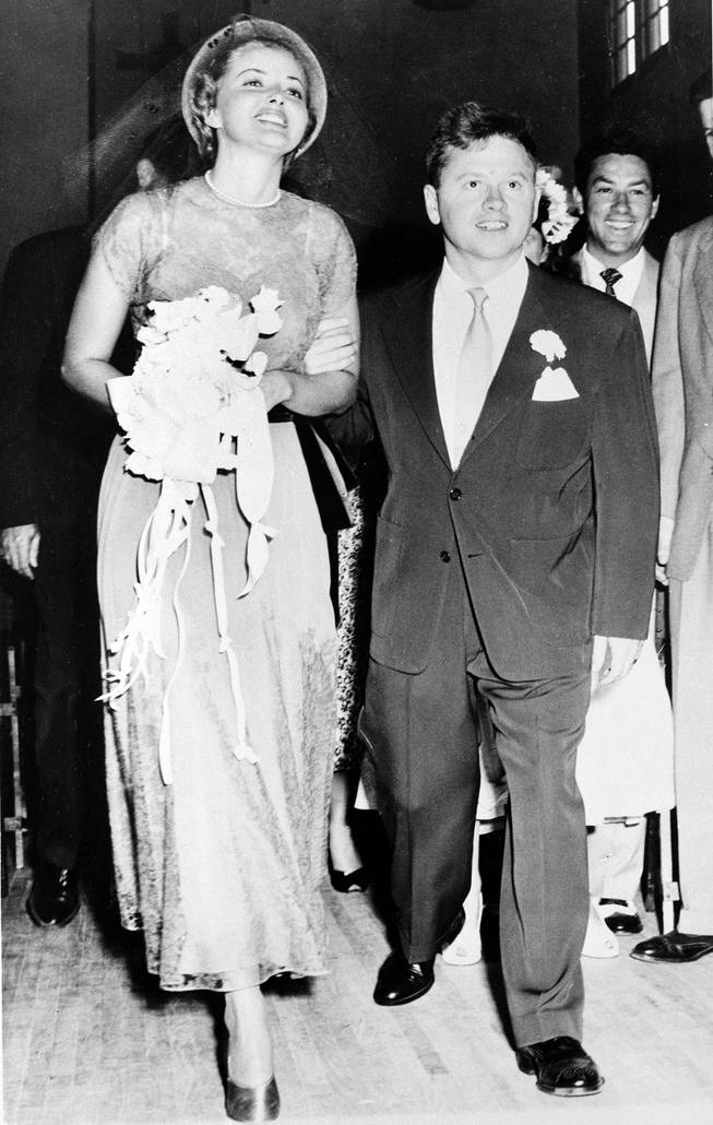 Actor Mickey Rooney and his bride, actress Martha Vickers, smile happily as they walk down the aisle of a church in North Hollywood, Calif., shortly after their wedding ceremony, June 3, 1949.