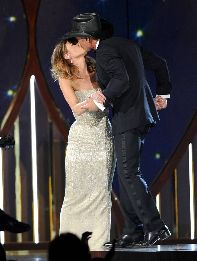 Faith Hill, left, and Tim McGraw kiss on stage at the 49th annual Academy of Country Music Awards at the MGM Grand Garden Arena on Sunday, April 6, 2014, in Las Vegas.
