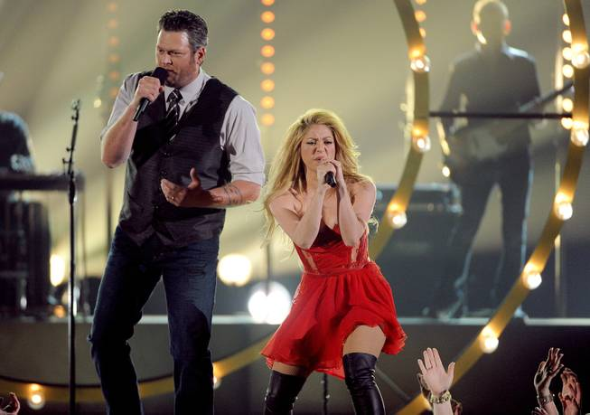 Blake Shelton, left, and Shakira perform on stage at the 49th annual Academy of Country Music Awards at the MGM Grand Garden Arena on Sunday, April 6, 2014, in Las Vegas.
