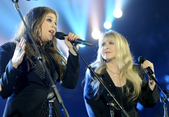 Hillary Scott, of the musical group Lady Antebellum, left, and Stevie Nicks perform on stage at the 49th annual Academy of Country Music Awards at the MGM Grand Garden Arena on Sunday, April 6, 2014, in Las Vegas.