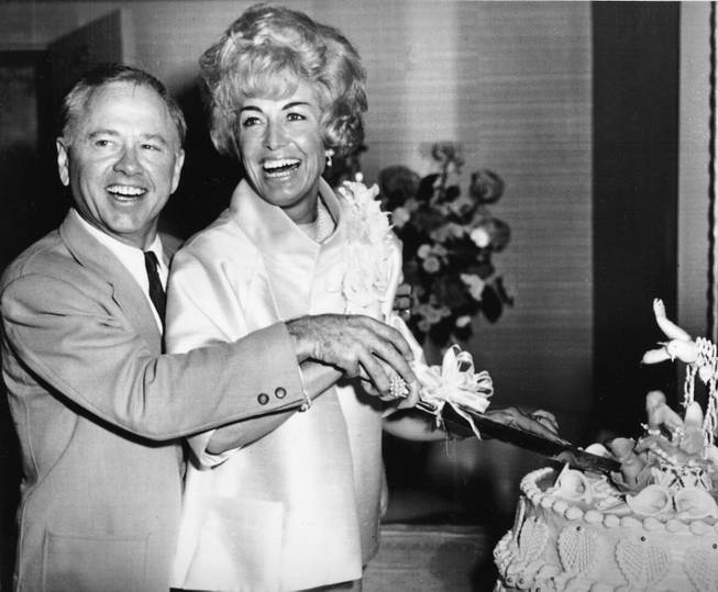 Actor Mickey Rooney and his new wife Margie Lane cut the cake at their wedding reception at the Desert Inn Hotel Casino in Las Vegas, Nev., on September 10, 1966.