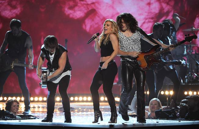 Neil Perry, from foreground left, Kimberly Perry and Reid Perry, of the musical group The Band Perry, perform at the 49th annual Academy of Country Music Awards at the MGM Grand Garden Arena on Sunday, April 6, 2014, in Las Vegas.